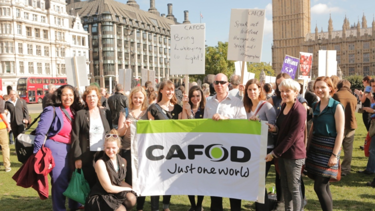 CAFOD supporters attend the freedom of speech rally in parliament square ahead of the lobbying bill's third reading in Parliament