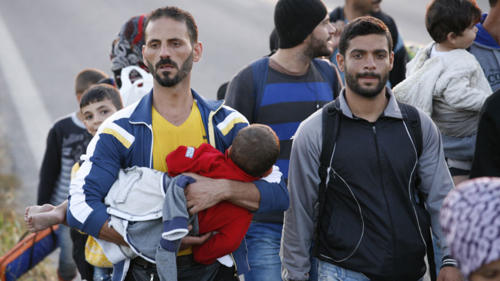 Refugees walking for safety in Greece