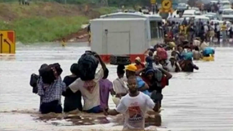 People wading through water - severe flooding in Mozambique has affected thousands of people in the aftermath of Cyclone Idai.