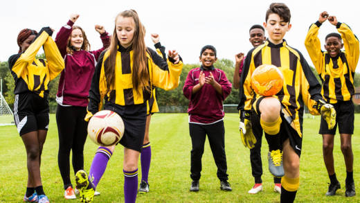 Young people demonstrating a keepie uppie football challenge for CAFOD