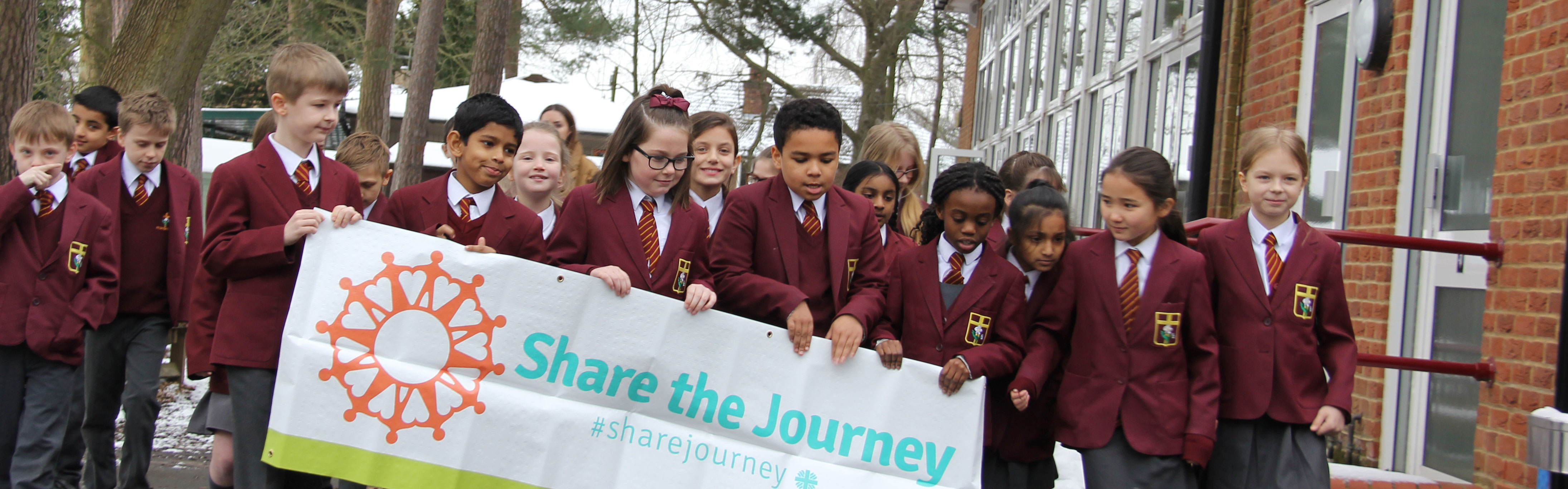 Children joining Share the Journey