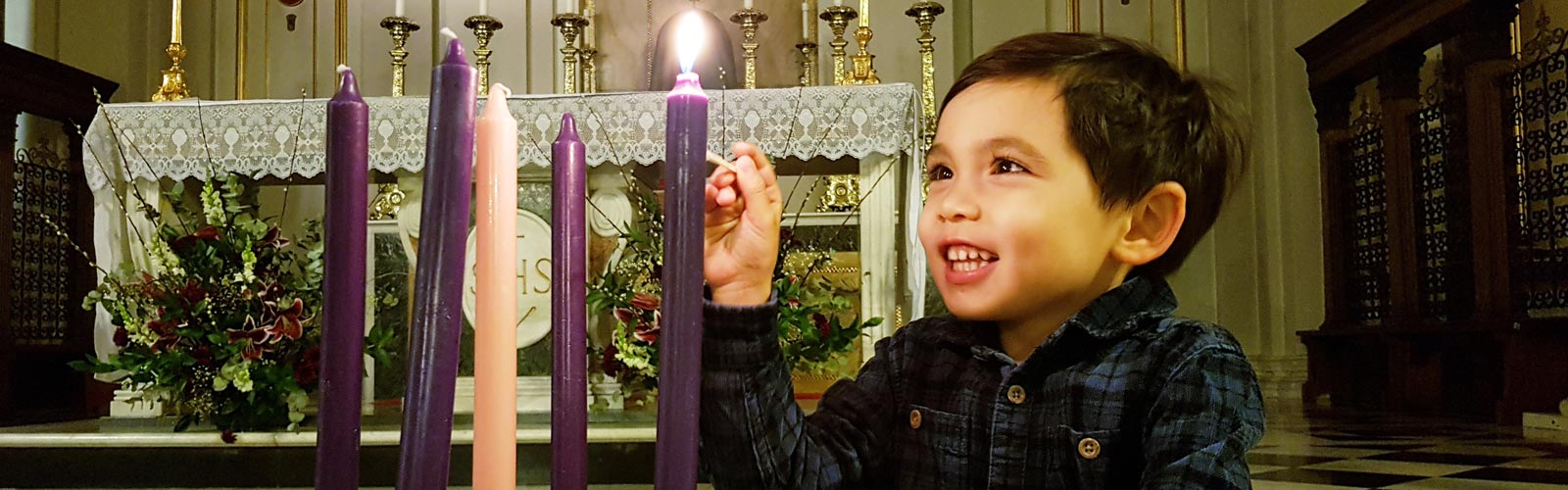 Boy lighting an Advent candle
