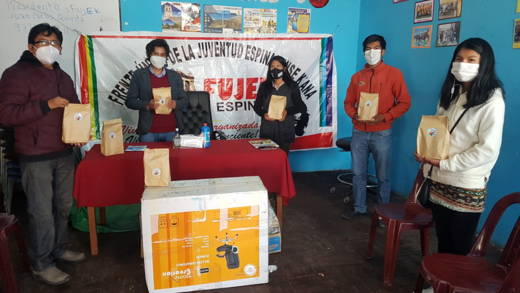 Local partners pose with hygiene kits