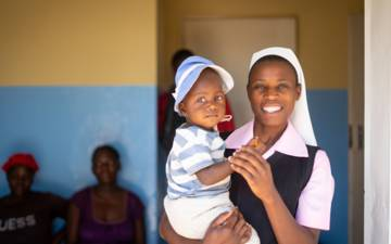 Sister Consilia with a child