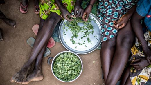 Refugees prepare food in Uganda