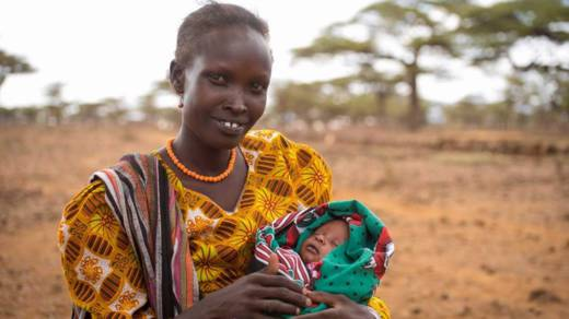 A mother holding her baby in East Africa