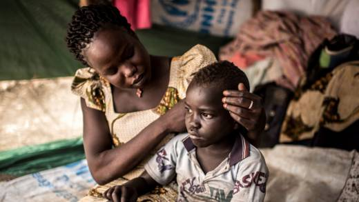 Viola and her son in a refugee camp Caritas Uganda