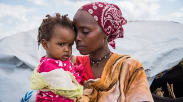 Amina and baby refugee camp Kenya