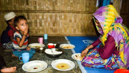 Saba shares a meal with her children in a refugee camp in Bangladesh