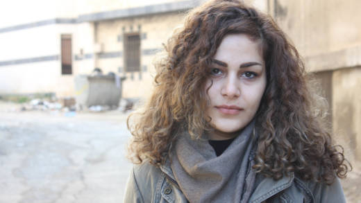 Fadia stands in a street in Syria