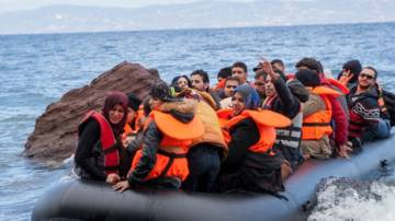 Refugees arrive by boat in Greece