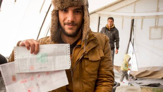 Syrian refugee with his unversity certificate