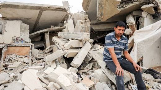 Man outside home in Gaza CAFOD