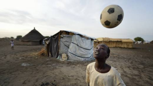 Boy plays with football refugee camp South Sudan CAFOD Lent