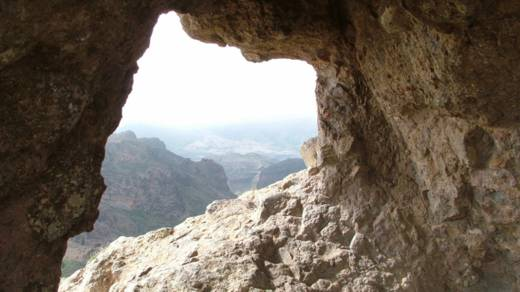 Looking out of the mouth of an empty cave