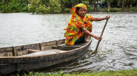 Mahinur in her boat on the river that separates her home from the rest of the village