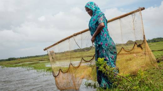 Mahinur takes her fishing net to the river by her home in Bangladesh
