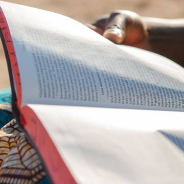 Reading scripture at home in Zambia.
