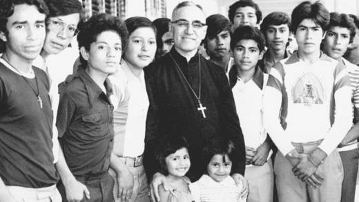 Archbishop Oscar Romero with some of the young people of El Salvador.