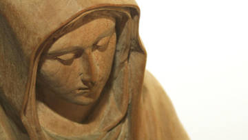 A carved statue of Our Lady.