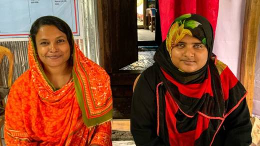 Farida Yasmin, left, with Tanya who has been helped by the Disabled People's Organisation
