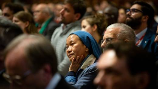 A picture of the congregation at a Mass celebrated by Pope Francis in St Peter's Basilica. A religious sister is in focus.
