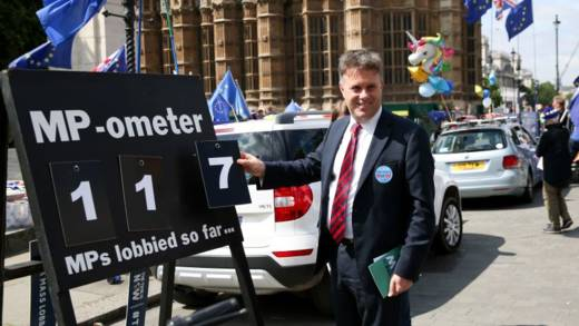 Man next to board counting the number of MPs lobbied