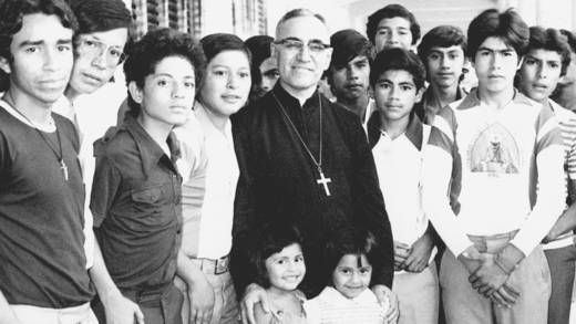 Oscar Romero surrounded by young people and children.