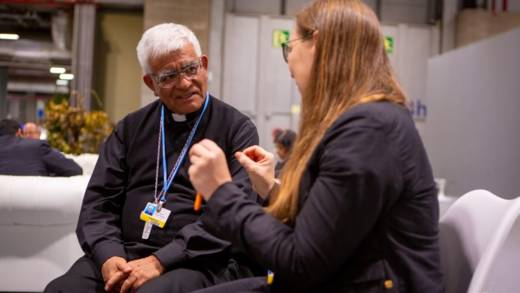 Archbishop Héctor Miguel Cabrejos Vidarte (President of CELAM - the Latin American Bishops' Council) listens to Anika Schroeder from Misereor at the conference centre in Madrid during COP25 in 2019.