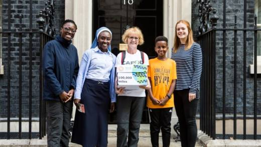 Five CAFOD representatives outside 10 Downing Street with a petition