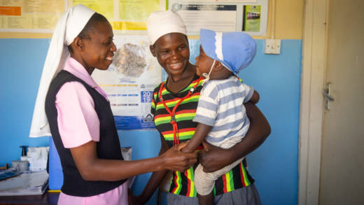 Sr Consilia greets her smiling patient