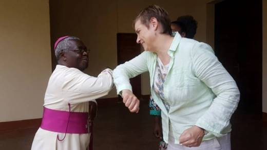 CAFOD Director Christine Allen greets the Archbishop of Bukavu in eastern DR Congo.