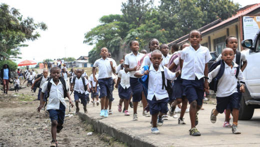 School children at a primary school running to an evacuation site
