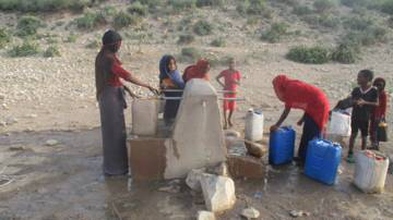 Children collect water from a water pump in northern Ethiopia.