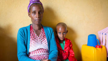Rahel has been working on a CAFOD project to build a dam. This has meant she now has money to buy food for her family.