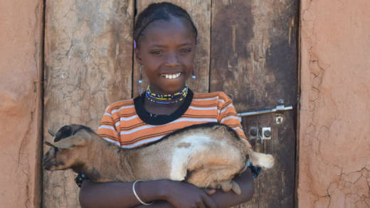 World Gifts Ethiopian girl holding a goat