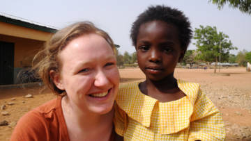 Amy Volunteer with Blessing in Ghana