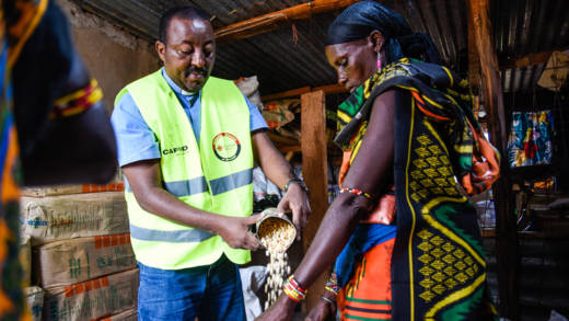 Fr Racho gives out food at a CAFOD-funded food distribution in Marsabit County, Kenya.