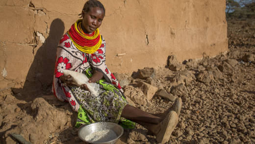 Mary Nater, pours rice into a bowl before she starts sifting it at her home in Daaba village, Isiolo. CAFOD through Caritas Isiolo distributed food vouchers which villagers could redeem for foodstuff at the store.