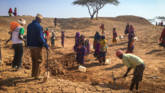 People digging a bore hole in Kenya. CAFOD is helping people affected by climate change.