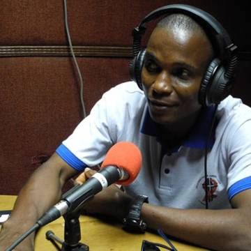 Philip McKay volunteer, leader of BOCAP (Bong County Awareness Programme) taking part in a county broadcast radio discussion on HIV/AIDS.