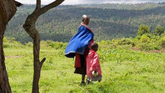 Rose Lenyarua and daughter Tabitha walk across hillside in Kenya