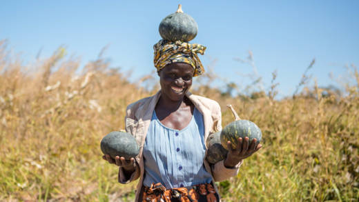 Woman holding gourds in Zambia