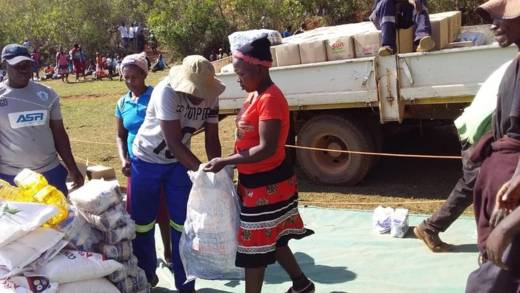 Families who are struggling to find enough to eat because of the food crisis in Zimbabwe are given cooking oil, maize meal, salt, rice and beans at a distribution in Mutare.