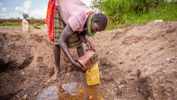 Longora collecting water from a local stream