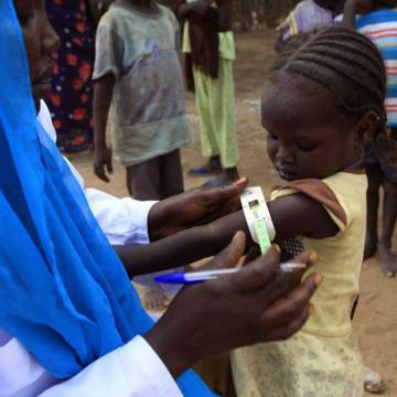 A little girl being tested for malnutrition at a mobile clinic