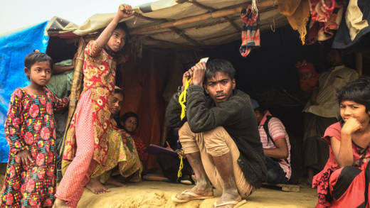 Man and children shelter in the Rohingya refugee camp
