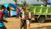 Caritas Aid workers delivering aid after the Indonesia Tsunami
