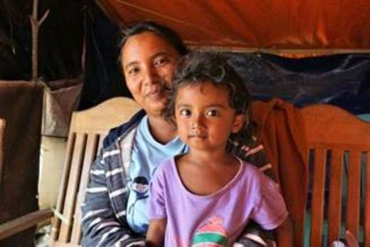 Nining (25) with her youngest daughter Tiara (3) at their emergency shelter in Jono Oge, Sigi.