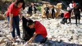 Young people clean a beach in Lebanon